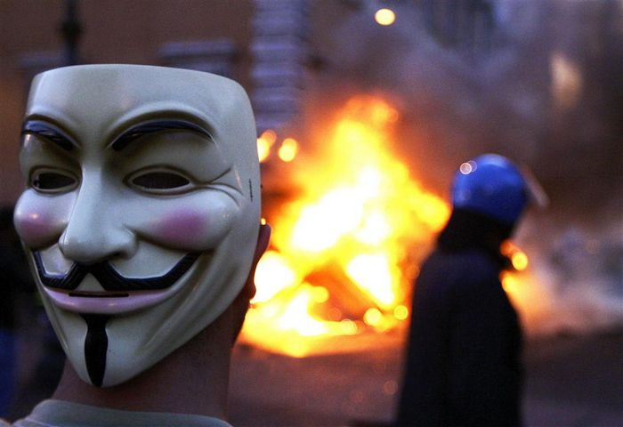 a_protester_wearing_a_guy_fawkes_mask_lguy fawkes v for Vendetta